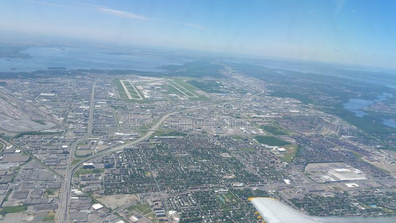 Flying over Montreal, Canada royalty free stock image