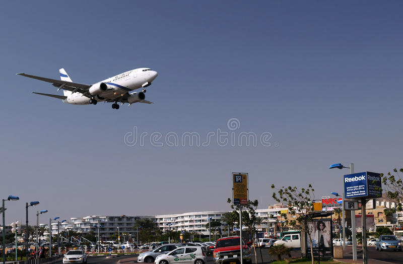 Flying Over Eilat. Passenger plane of Israeli airline flies low over the city of Eilat on the coast of the Red Sea in Israel seconds before safe landing in the royalty free stock photo