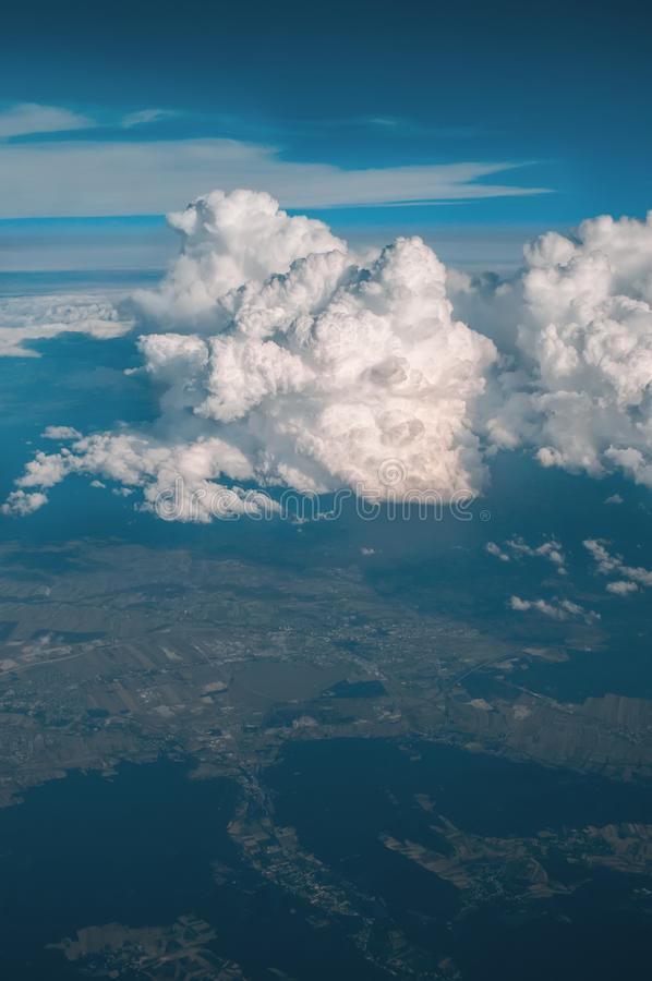 Flying over the evening time zone clouds with late sun. Flying through moving clouds. Air travel. Perfect for movies royalty free stock photo