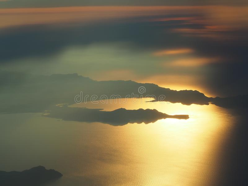 Flying over the island of Majorca during sunset. View from the airplane window. Mallorca, Spain. Summer time royalty free stock images