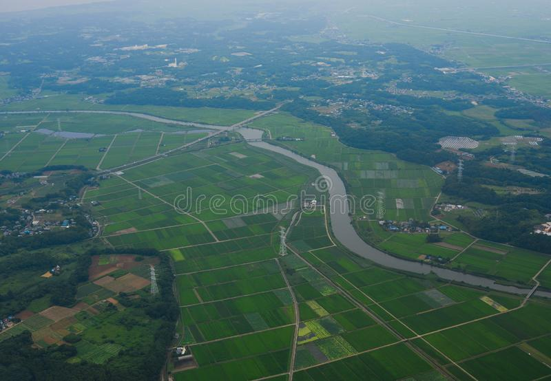 Flying over rural scenery in summer day stock photos