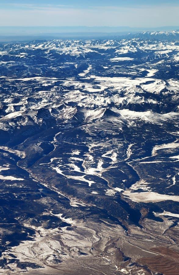 The San Juan mountains in the Colorado Rockies. Flying over the San Juan mountains covered in snow in winter in the Colorado rockies stock image