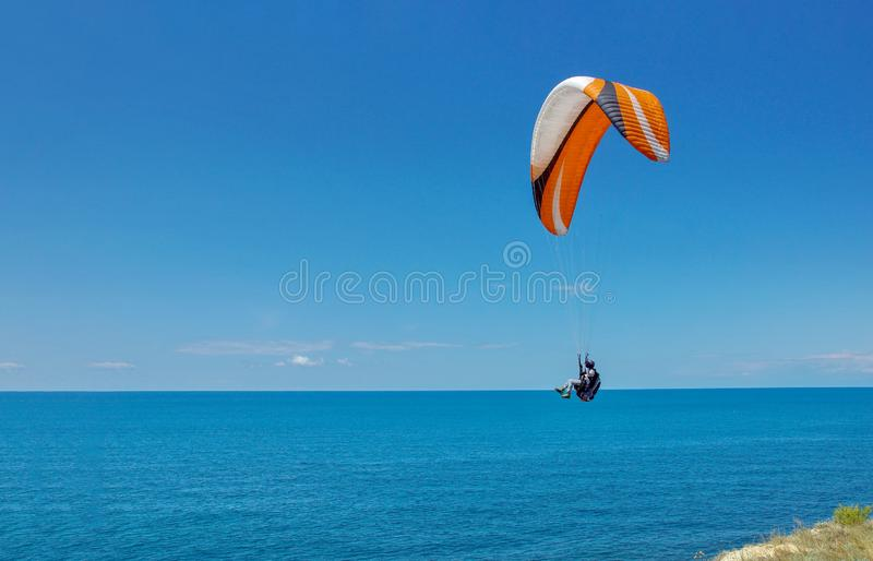 Flying over the sea on a paraglider sports vacation in the resort of Anapa stock images