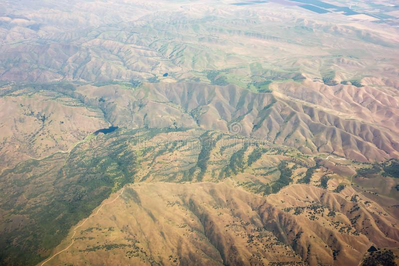 Flying over sierra national forest hills and valleys royalty free stock images