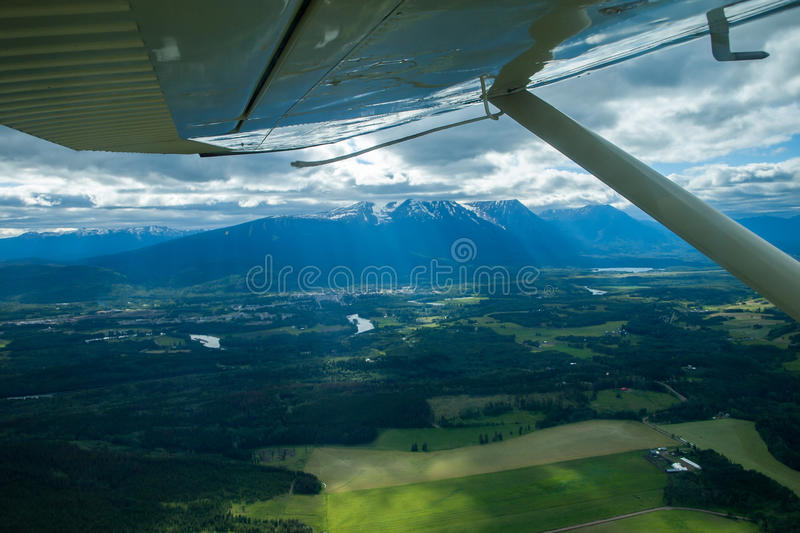 Flying over Smithers in floatplane. Landscape around Canadian town Smithers in British Columbia viewed from a floatplane stock image