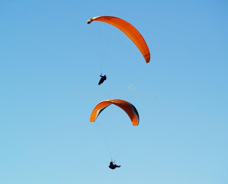 Flying paragilders. stock photos