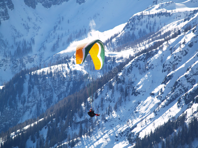 A flying paraglider. stock photos