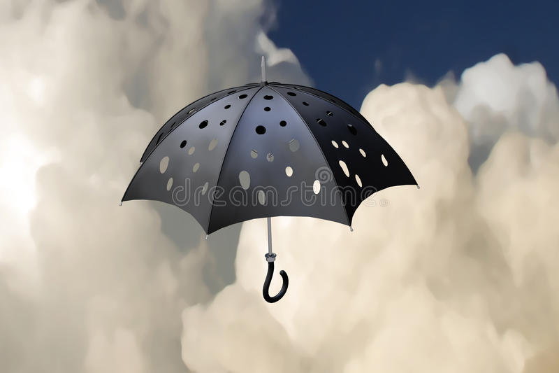 Flying pierced umbrella royalty free stock photography