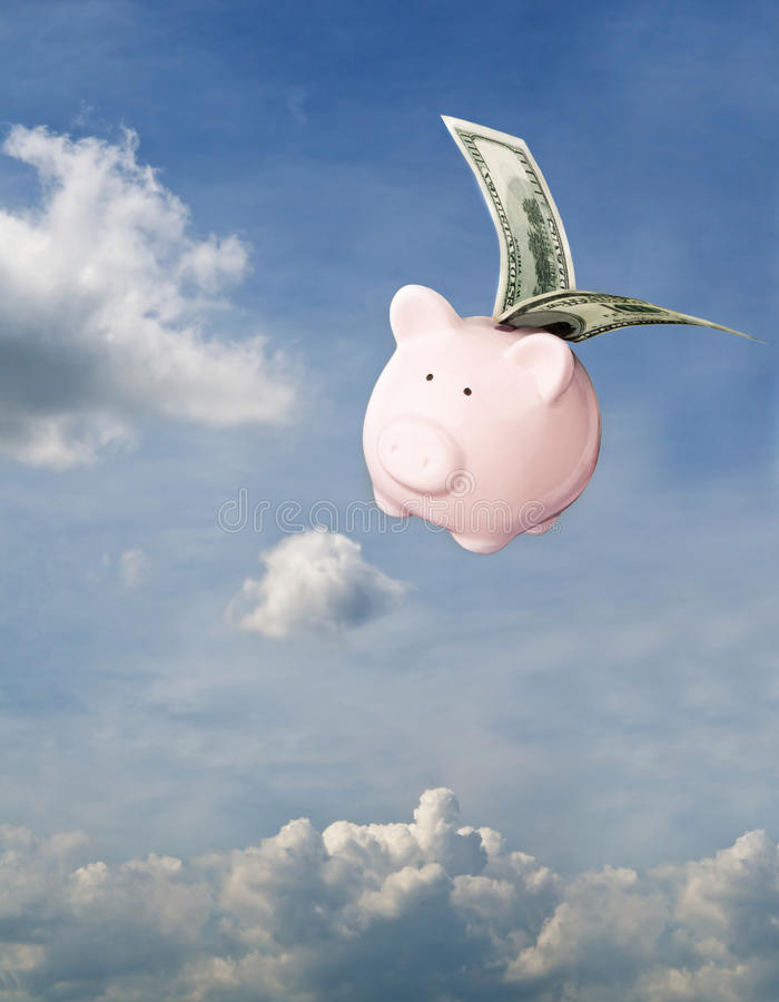 Flying piggy bank stock photos