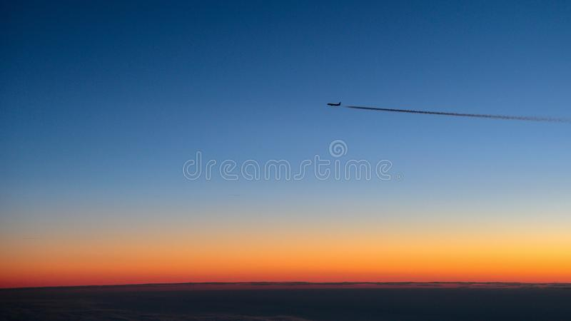 Flying by plane caught from another plane few minutes before the sunrise royalty free stock images