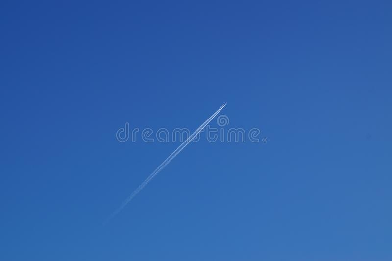 Flying the plane in the cloudless blue sky. stock photo
