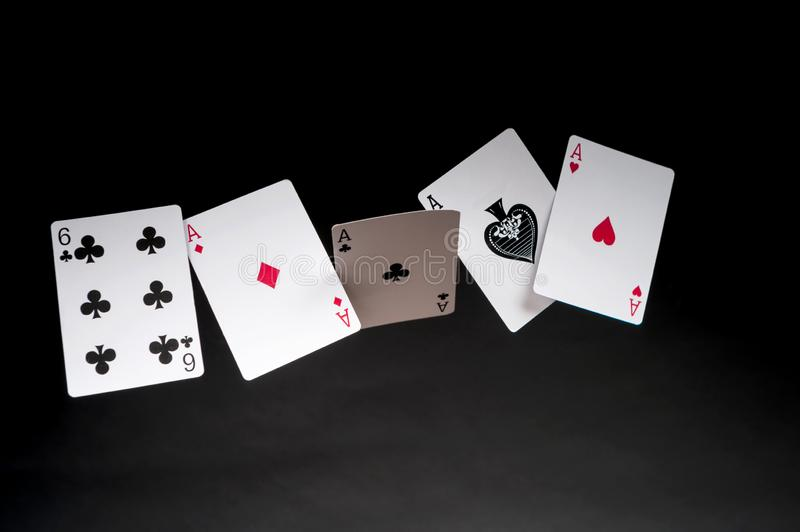 Poker quads. Flying playing cards on a dark background - poker quads stock photography