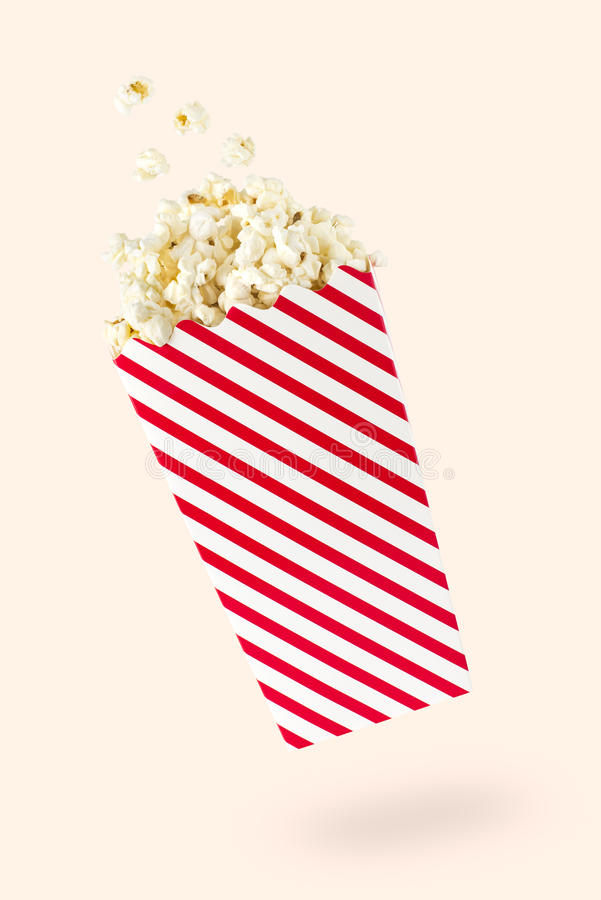 Free Flying Popcorn With Red-touched Packet Royalty Free Stock Image - 76228946