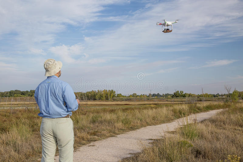 Flying quadcopter drone stock photography