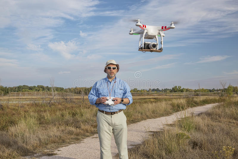 Flying quadcopter drone royalty free stock photos