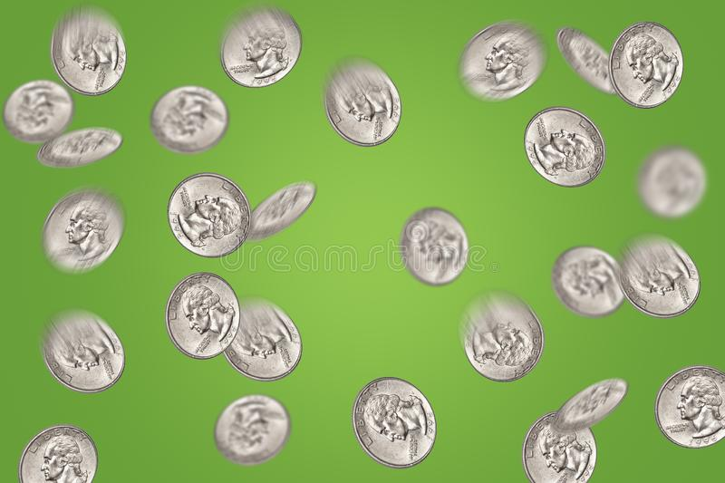 Flying quarter dollar coins. Abstract flying quarter dollar coins on green background. Money win, prize concept stock photo