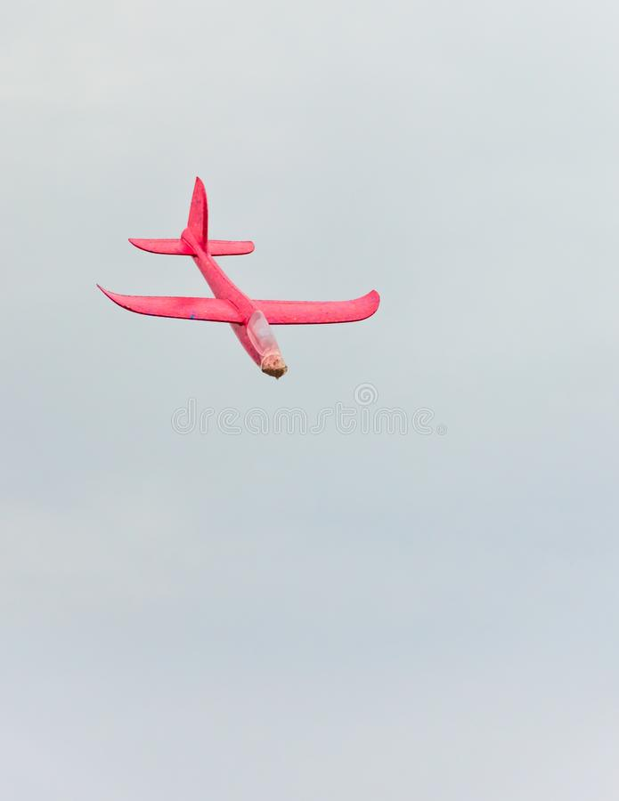 Flying red toy plane royalty free stock photography