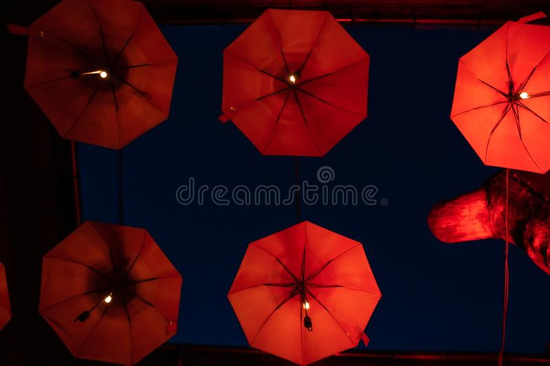 Flying red umbrellas pattern, part of inner courtyard decoration design, by night royalty free stock photos
