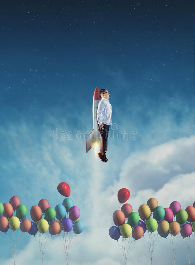 Flying rocket above balloons royalty free stock photo
