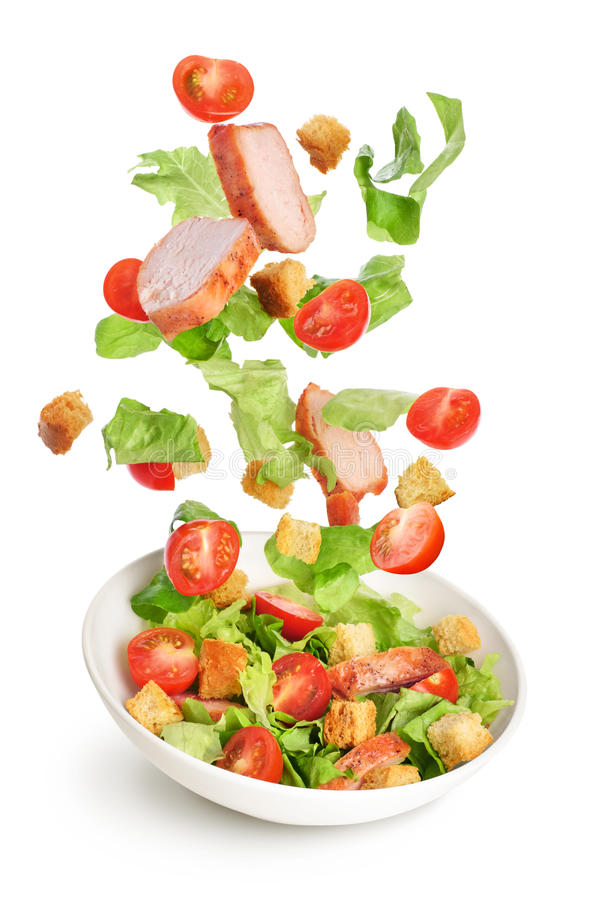 Flying salad ingredients isolated on white background. Caesar sa. Lad stock image