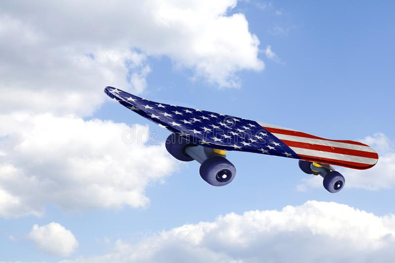 Flying Skateboard with USA flag on blue sky and clouds. Flying Skateboard with USA flag on a blue sky and clouds royalty free stock photos