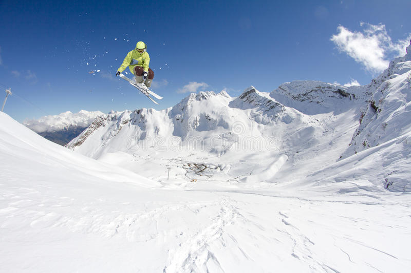 Flying skier on mountains. Extreme winter sport. Flying skier on mountains. Extreme winter ski freeride sport stock photo