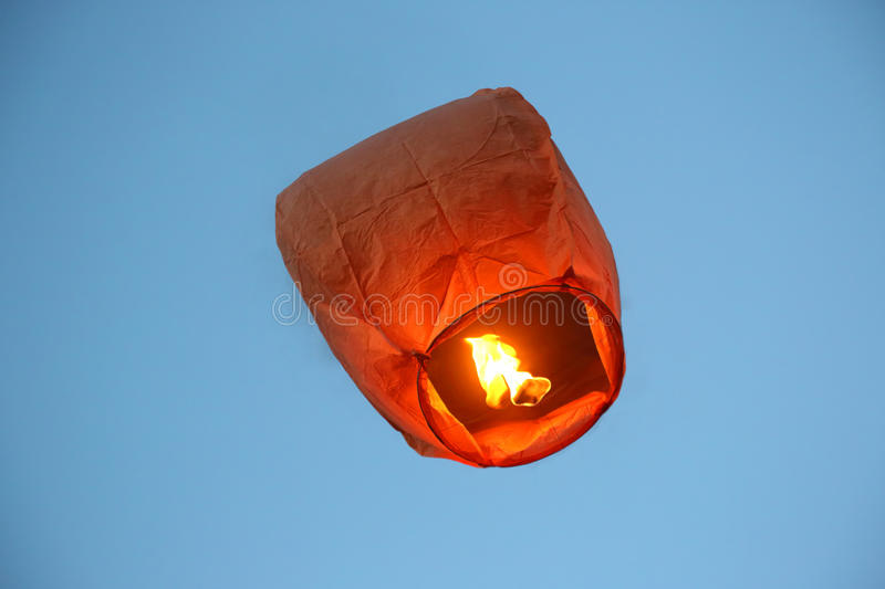 Flying in the sky fire paper lantern royalty free stock images