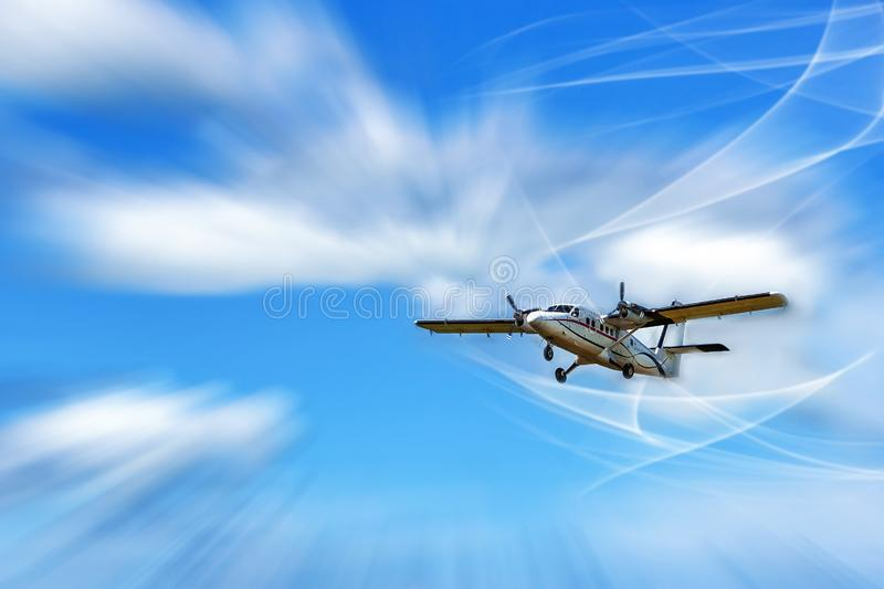 Flying small passenger propeller aircraft in the streams of air. Mixed media stock photos