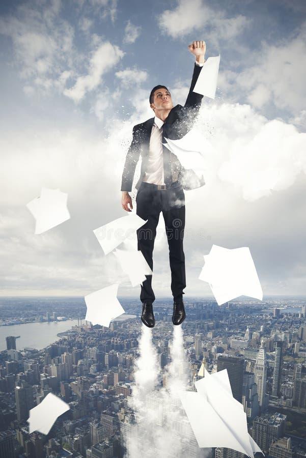 Flying Super hero businessman. Super hero businessman flying in the sky royalty free stock image