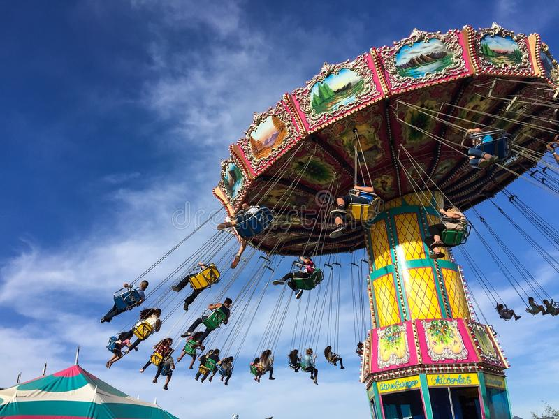 Flying swing carnival rides at a local street fair stock photography
