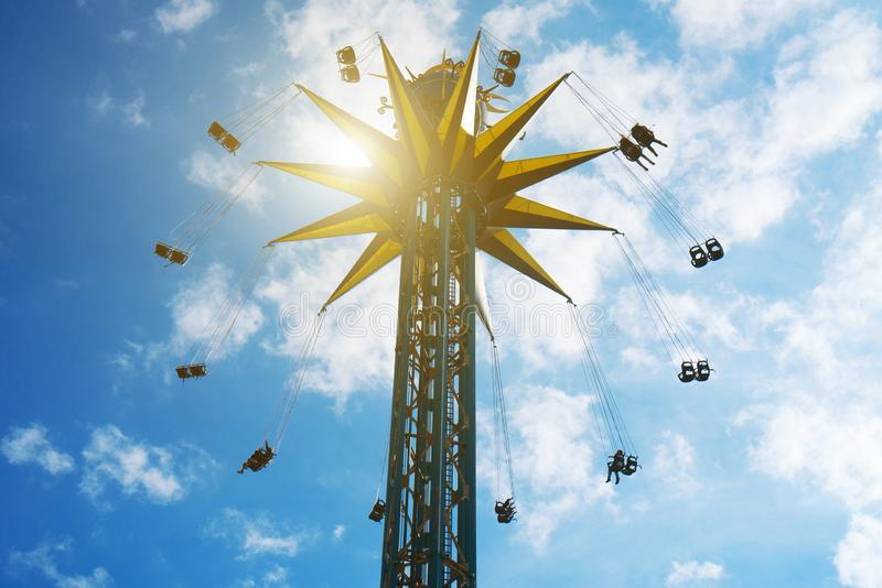 Flying swinging high chained carousel. royalty free stock photo