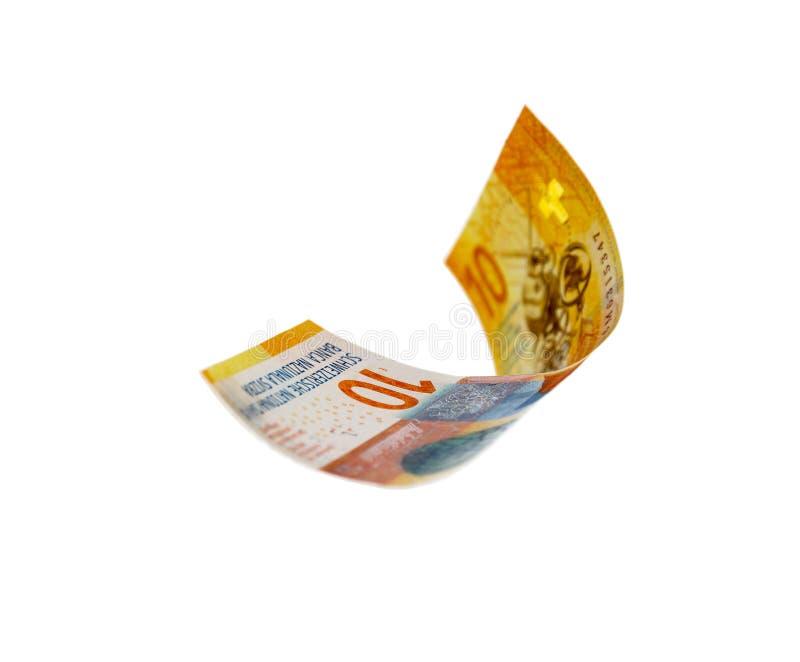 Flying Swiss money over white royalty free stock photo