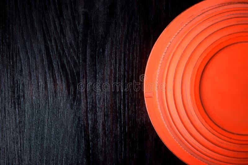 Flying target plate for shotgun sport against the dark wooden background royalty free stock photo