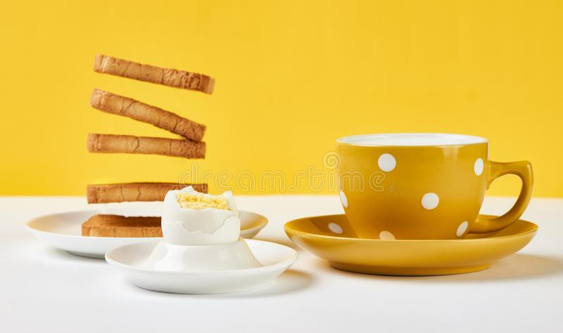 Flying toasts for breakfast and cup of fresh milk with chicken e stock photo