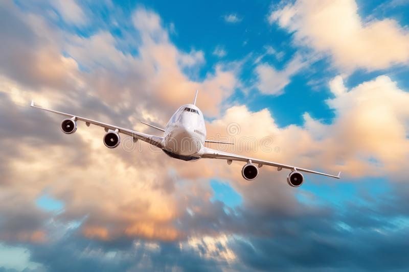 Flying and traveling above the clouds, evening sunset voyage airplane motion speed.  stock images