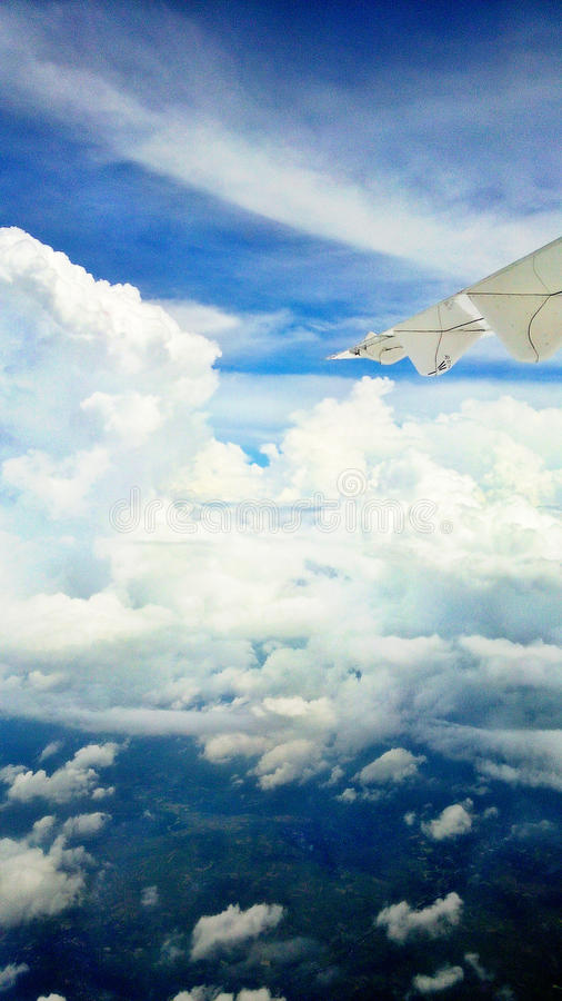 Flying trip to surabaya, indonesia. Flying with the wings, cloud and sky royalty free stock photography