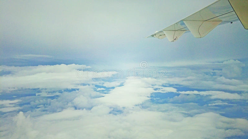 Flying trip to surabaya, indonesia. Flying with the wings, cloud and sky stock photography