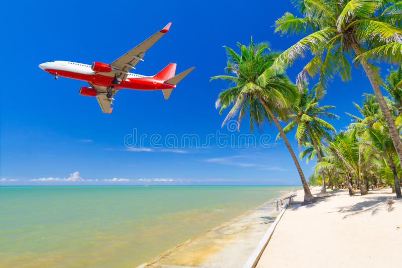 Flying for tropical holidays. Airplane flying from tropical airport stock images