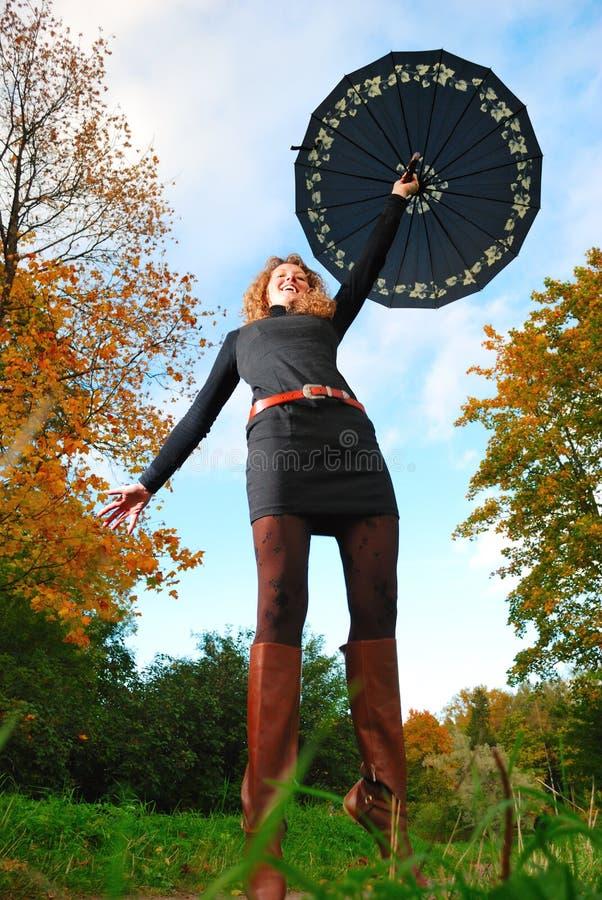 Flying an umbrella stock photos