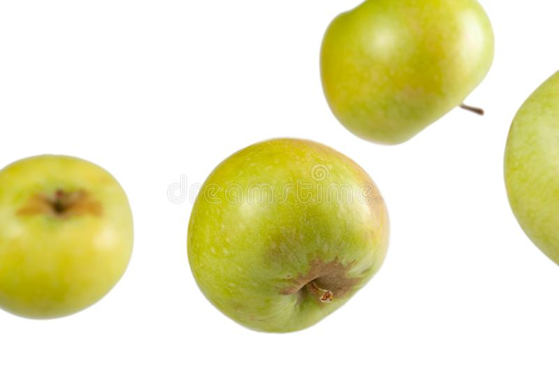 Falling whole green apples royalty free stock photography