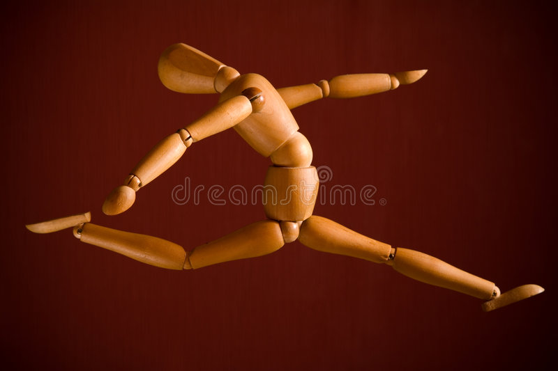 Flying wooden puppet. Over red background royalty free stock photos