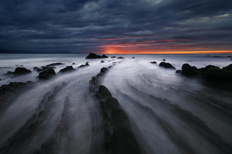 Flysch rocks in barrika beach at sunset stock photos