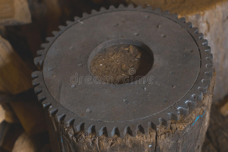 Flywheel old on a wooden stump in the workshop. royalty free stock photos