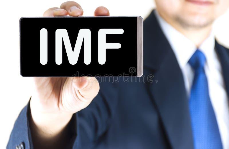 FMI (fondo monetario internazionale), Fondo monetario internazionale, parola sullo schermo del telefono cellulare fotografia stock libera da diritti
