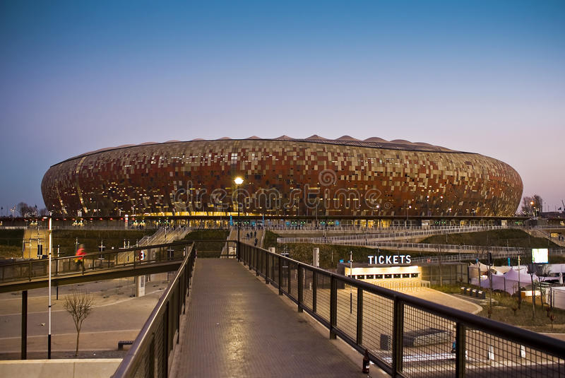 FNB Stadium - National Stadium (Soccer City). Pedestrian bridge leading into the entrance for the stadium. FNB Stadium, or The National Stadium (and formerly stock images