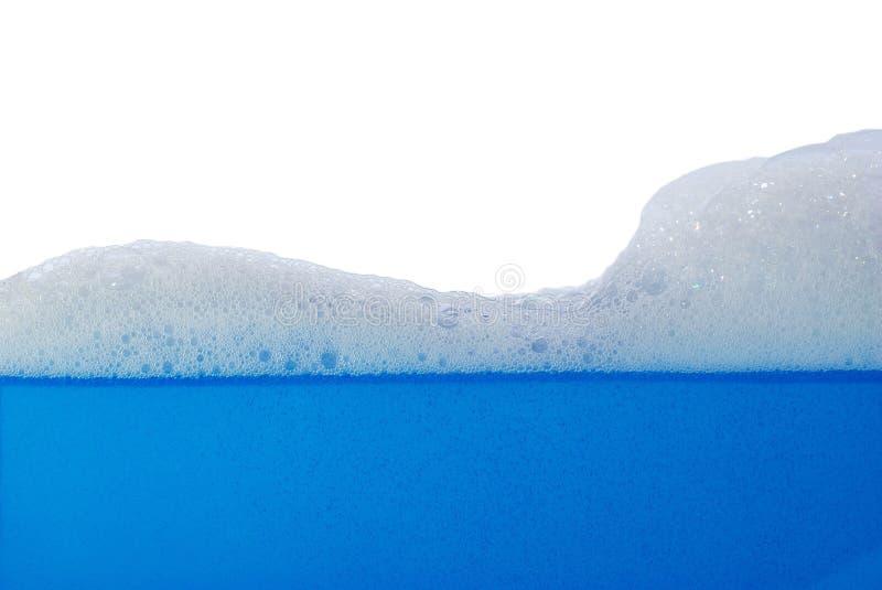 Foam afloat. On white background royalty free stock photos
