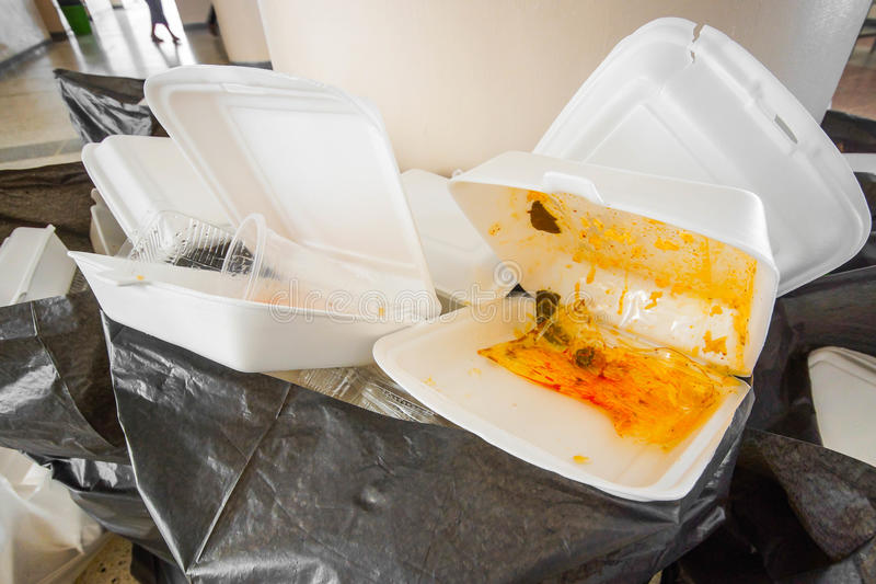 Foam boxes using. Foam food containers in the bin - Takeaway food and environmental problems concept stock images