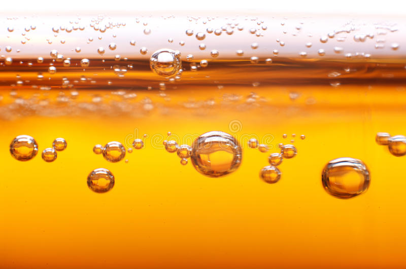 Foam and bubbles of beer. royalty free stock photo