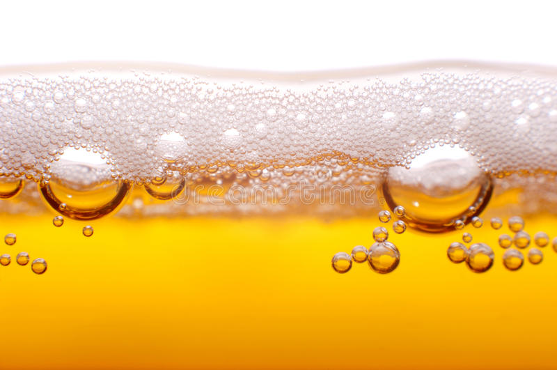 Foam and bubbles of beer. royalty free stock images