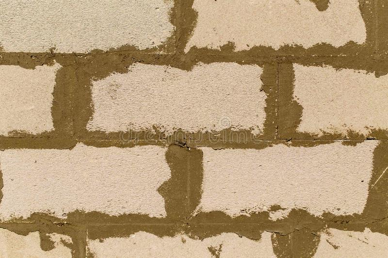Foam concrete bricks in the wall as an abstract background royalty free stock image